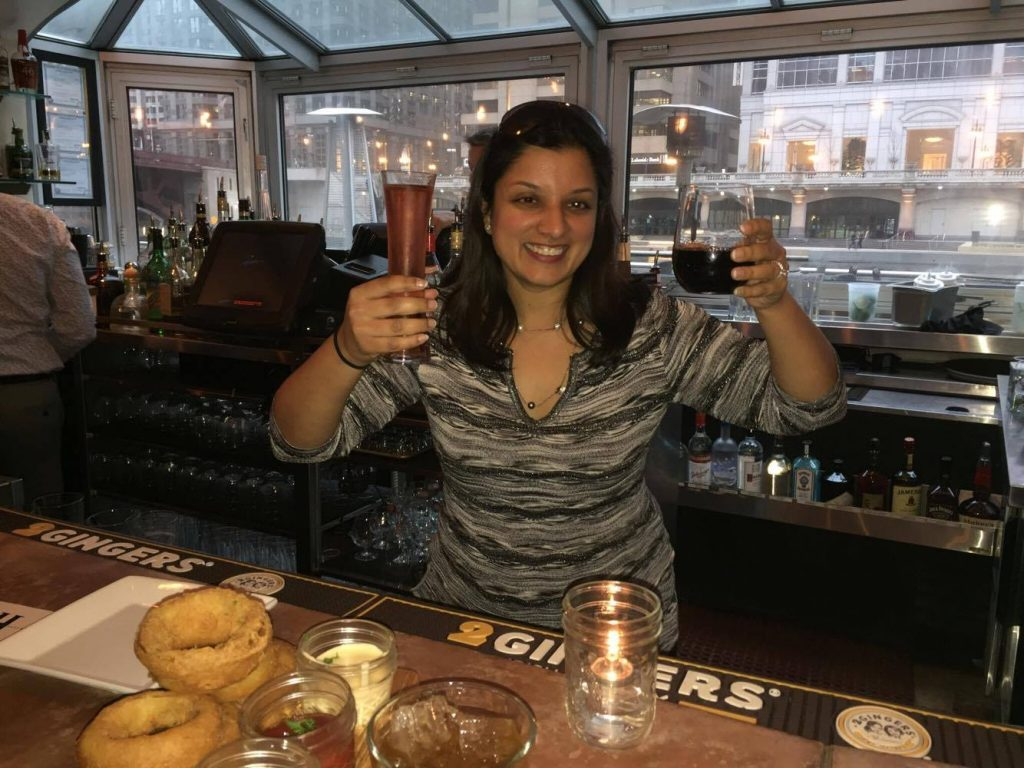 Dr. Jain, our inspirational spotlight for the month, serves up drinks in an effort to raise money for the field in which she works, oncology and hematology